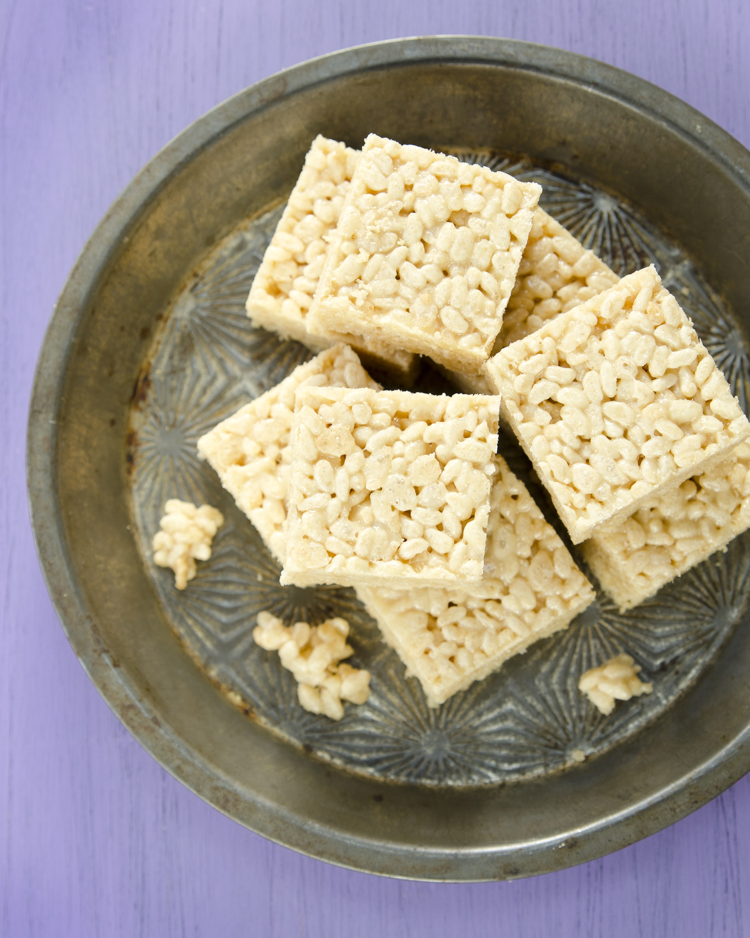 overhead photo of rice krispie treats cut and assembled on pewter tray