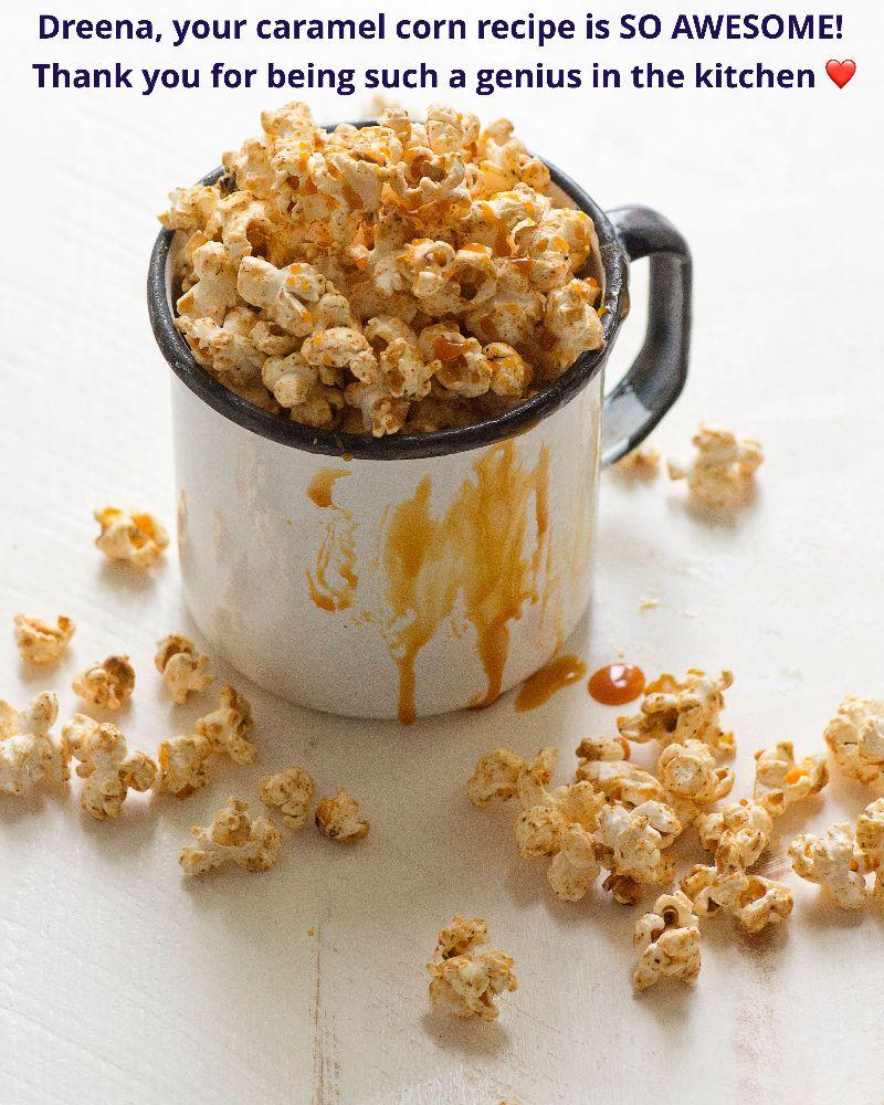 Caramel Corn in a large mug with caramel drippings