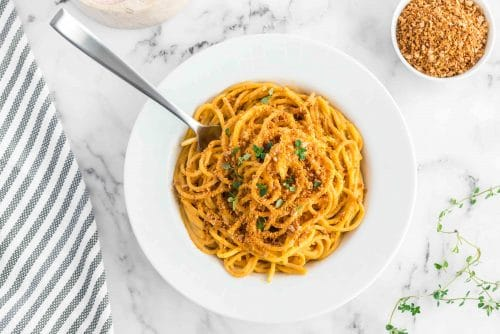 bowl sweet potato pasta sauce with noodles and smoky breadcrumbs in a bowl