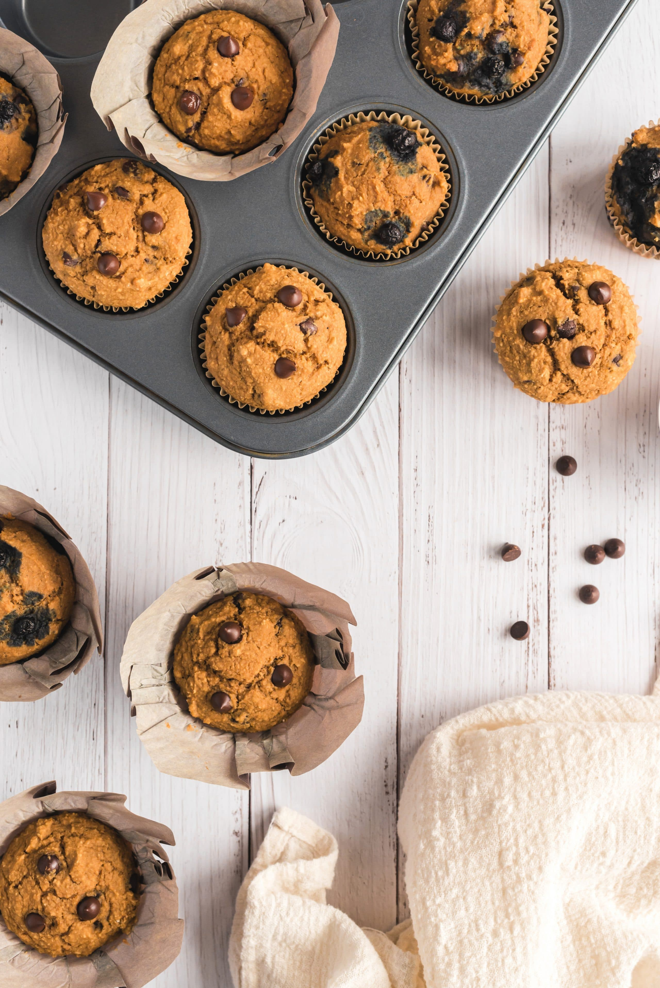 muffins in pan and on table