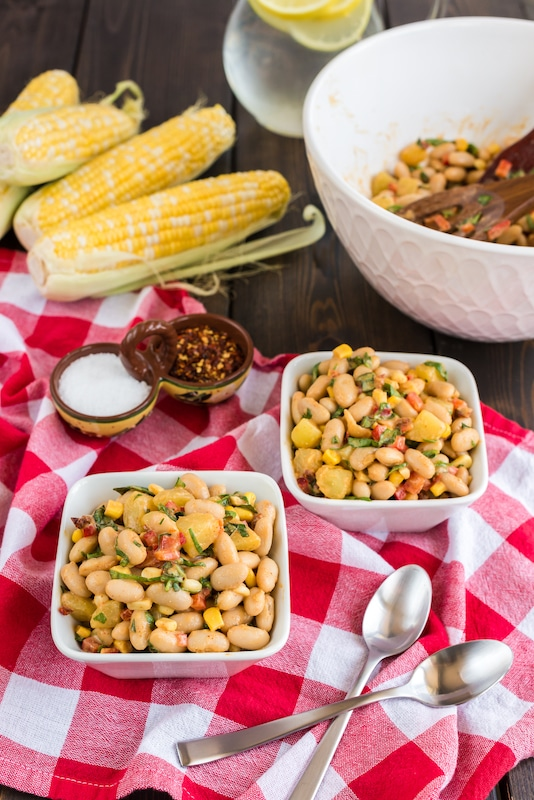 white bean salad in serving bowls
