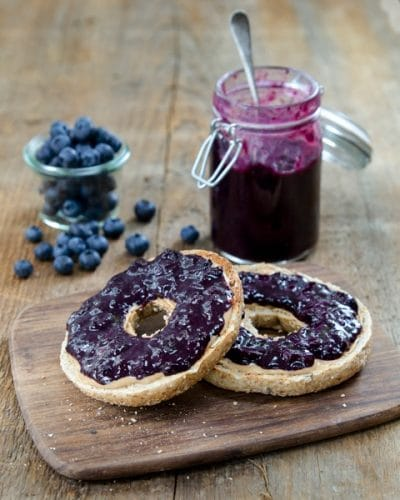 Sugar-Free Blueberry Jam on sliced bagel, and jar of berry jam in background