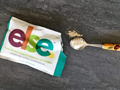 ELSE plant-based baby formula on a spoon
