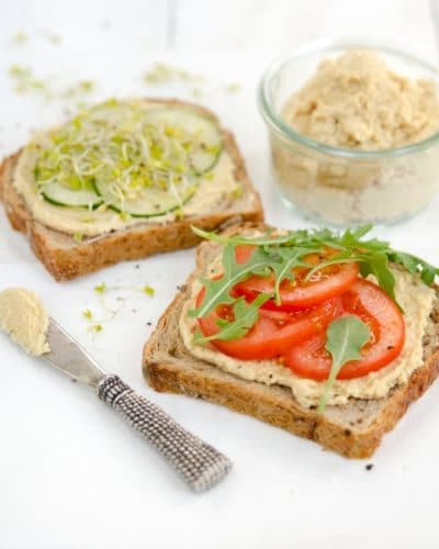 oil-free hummus on open face sandwiches with sliced tomatoes and cucumbers