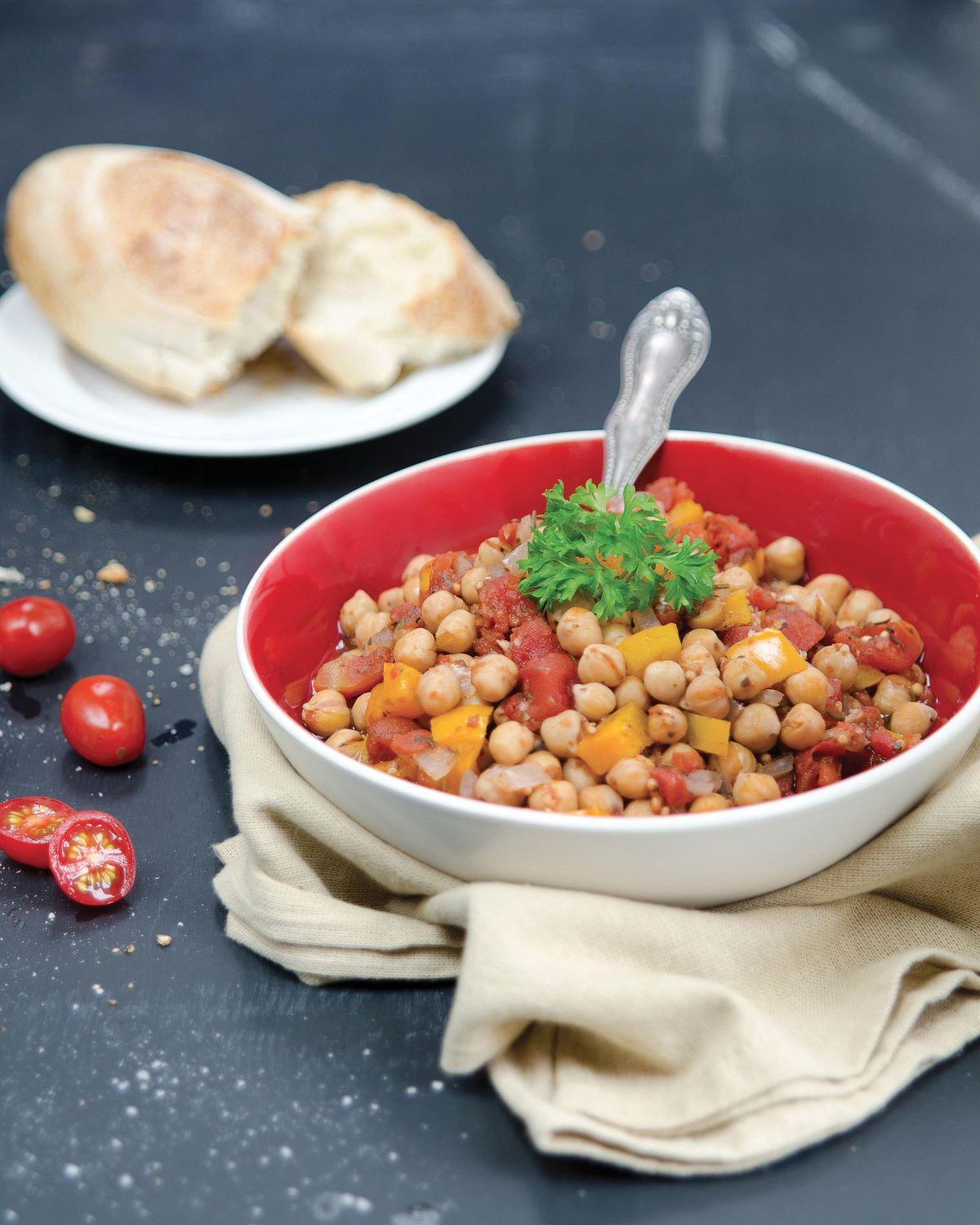 Bowl of chickpea ratatouille with bread on the side