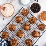 cinnamon bun muffins on cooling rack