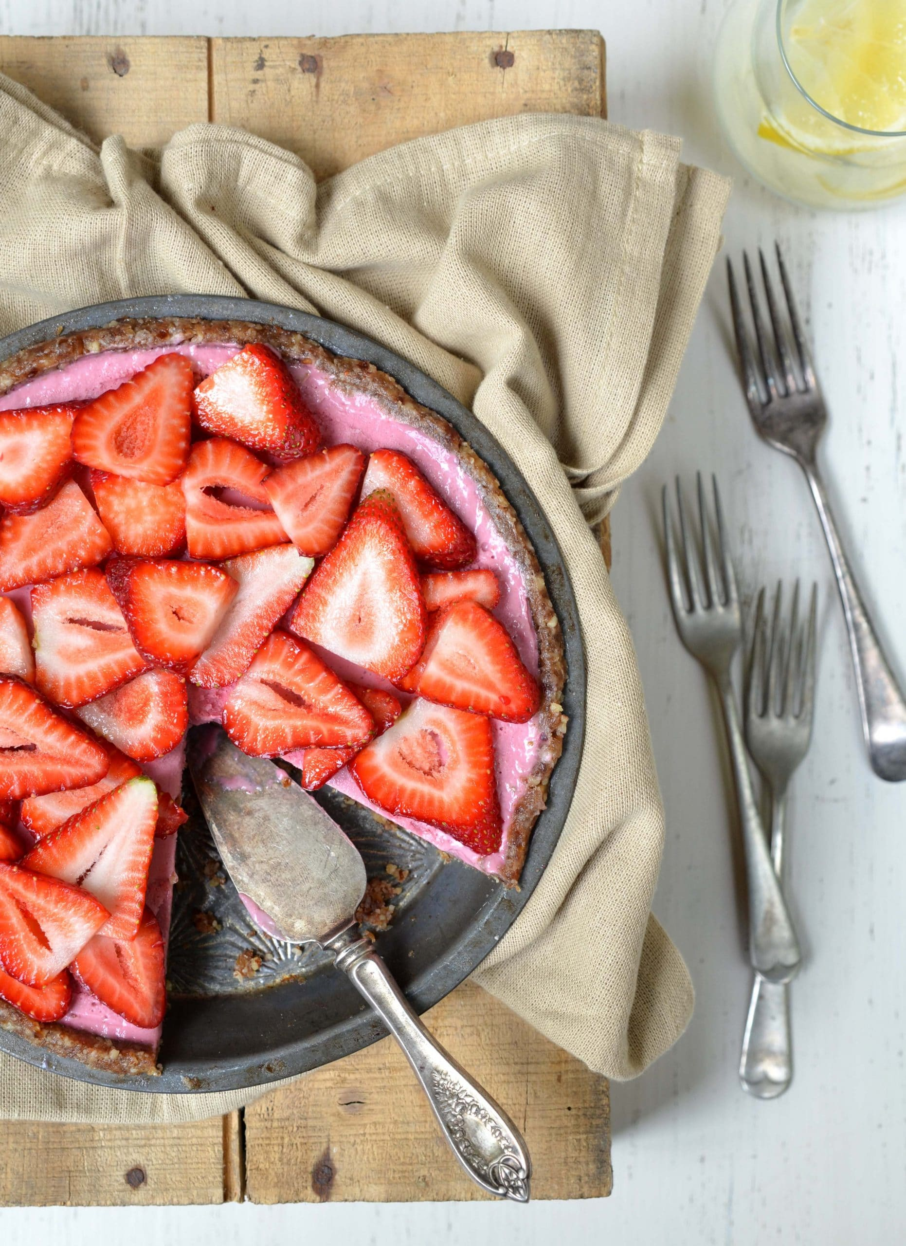 vegan strawberry pie with a slice missing from the pan