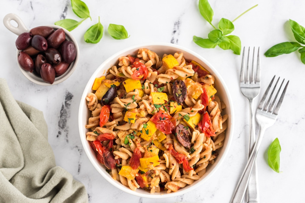 Bowl of Summer Pasta with zucchini, tomatoes, fresh basil and olives